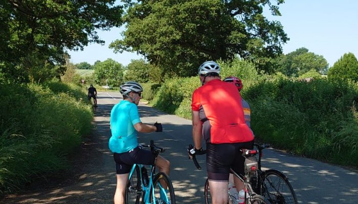 Test Ride cyclists riding into Great Wolford